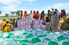 Refugees in Jamam camp queue up to receive buckets and soap as part of Oxfam's public health campaign to reduce the spread of diseases such as cholera, diarrhoea and Hepatitis E in the camp. Photo: Alun McDonald